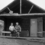 Couple in front of cabin: Adolph and Louise Murie